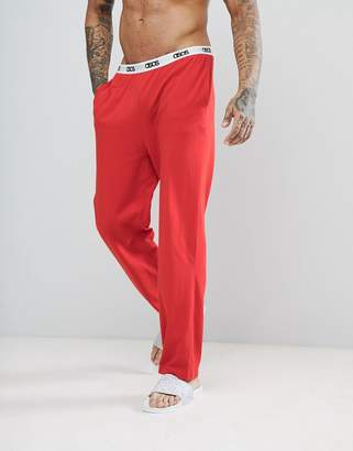 Asos Design Straight Leg Jersey Pyjama Bottom With Branded Waistband In Red