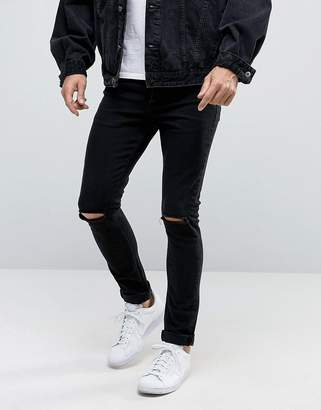 Asos DESIGN Super Skinny 12.5oz Jeans With Knee Rips True Black