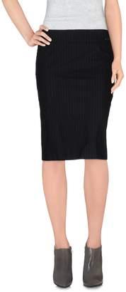 Exte Knee length skirts