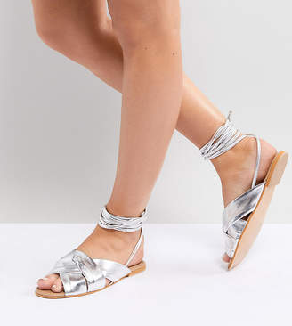 b4f0e4ef3d7696 Asos Design DESIGN Valley Wide Fit leather knotted tie leg flat sandals