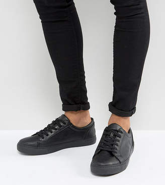 Asos DESIGN Wide Fit sneakers in black