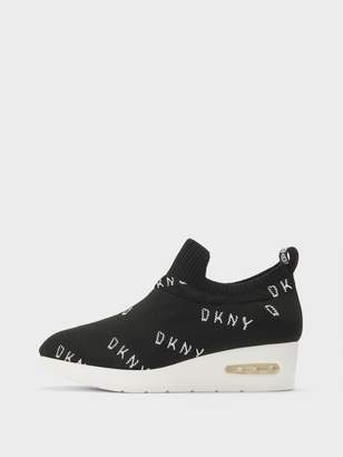3c1b68e8370 Dkny Black Wedge Sneakers - ShopStyle