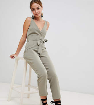 Asos DESIGN Petite wrap front jumpsuit with peg leg and self belt
