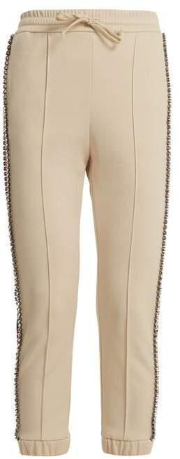 Crystal-embellished skinny-fit track pants