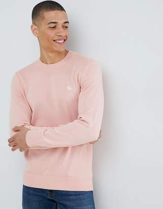 Abercrombie & Fitch core icon logo crew neck knit sweater in pink