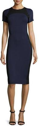 St. John Collection Luxe Sculpture Knit Short-Sleeve Dress, Navy/Caviar $1,095 thestylecure.com