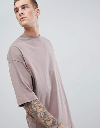 Asos DESIGN oversized longline t-shirt with deep curve hem in brown