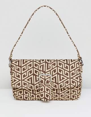 Asos Design DESIGN 90s shoulder bag in monogram