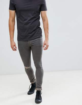 Asos DESIGN 12.5oz super skinny jeans in gray with knee rip