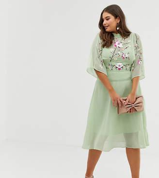Asos DESIGN Curve embroidered high neck 70s midi dress