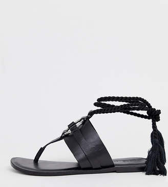 557bcfbee6 Asos Design DESIGN Wide Fit Vantage leather ring detail tie leg flat sandals  in black