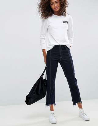 Asos DESIGN AUTHENTIC Straight Leg Jeans With Vertical Seam In Indigo With a Contrast Stitch