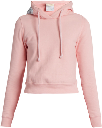 VETEMENTS X Champion hooded cotton-blend sweatshirt $620 thestylecure.com