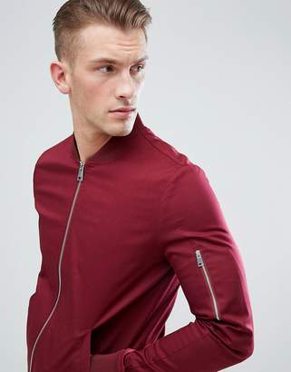 Asos DESIGN muscle fit bomber jacket with sleeve zip in burgundy