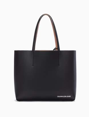 Calvin Klein ultra light reversible tote bag + wristlet zip pouch