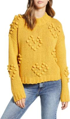 WOVEN HEART Placement Knot Knit Sweater