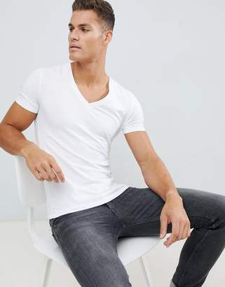 Asos Design DESIGN muscle fit t-shirt with deep v neck in white