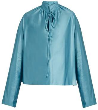 Balenciaga Buttoned-collar long-sleeved jersey blouse