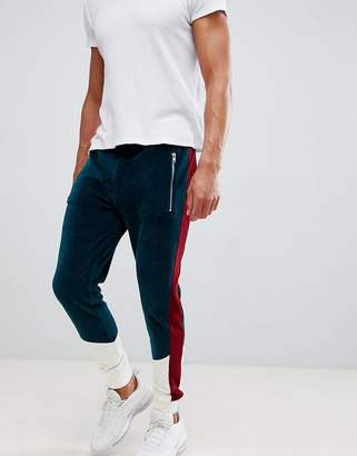 Asos DESIGN skinny joggers in velour with color blocking panels