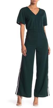 0cb3073a01be ... Love + Harmony Short Sleeve Athletic Stripe Jumpsuit