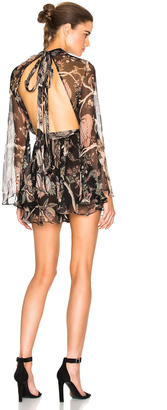 Zimmermann Lavish Flare Sleeve Romper $630 thestylecure.com