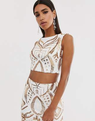 Goddiva high neck placement sequin crop top in white and gold