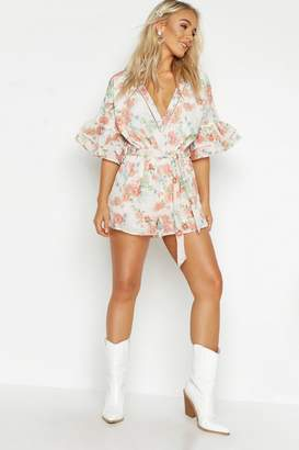 a22146dce2 boohoo Petite Floral Ruffle Sleeve Plunge Playsuit