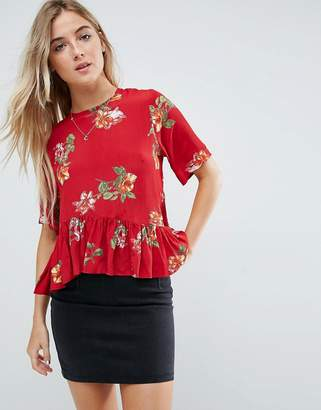 Asos DESIGN Tee with Asymmetric Ruffle Hem in Red Floral