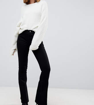 Asos DESIGN Petite bell flare jeans in clean black with pressed crease