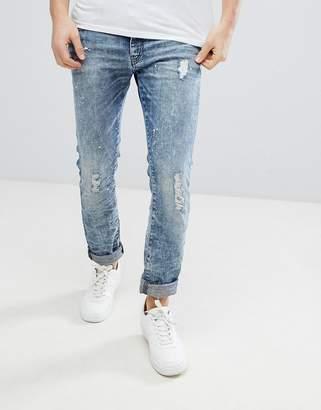 Armani Exchange J13 Slim Fit Distressed Light Wash Stretch Jeans