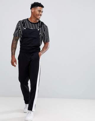 Asos Design DESIGN jersey dungarees in black with side stripe