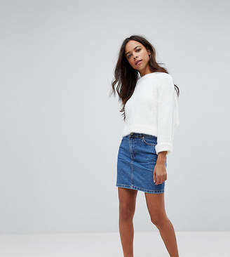 Asos DESIGN Petite denim original high waisted skirt in midwash blue