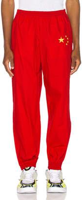 Vetements Flag Track Pants in Red   FWRD