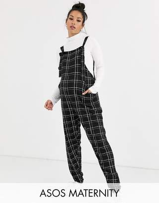 Asos DESIGN Maternity check print dungaree jumpsuit in jersey