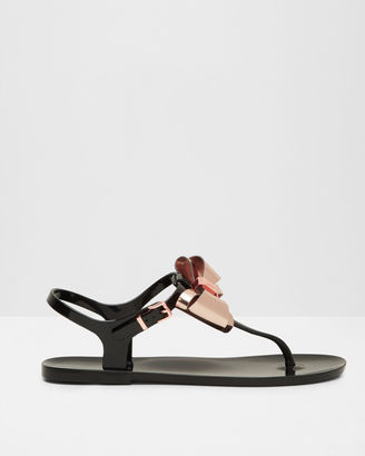 Metallic bow jelly sandals $85 thestylecure.com