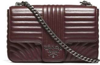 Prada Embossed Shoulder Bag From Red Embossed Shoulder Bag With Fold Over Top, Internal Compartment, Embossed Logo Plaque And Silver Tone Chain Strap