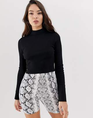 7c0b9913275 Asos Design DESIGN long sleeve crop top with turtle neck and raw hem in rib  in