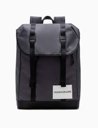 Calvin Klein embossed logo drawstring flap backpack