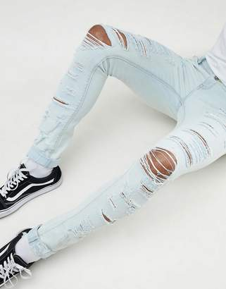 Asos DESIGN super skinny jeans bleach wash blue with heavy rips