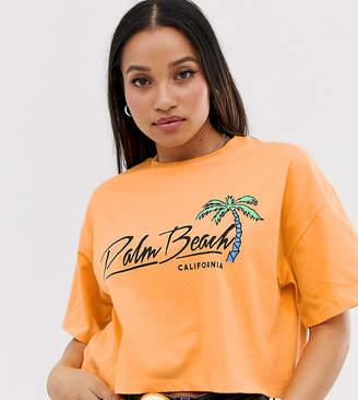 Asos DESIGN Petite t-shirt in wash with palm beach motif