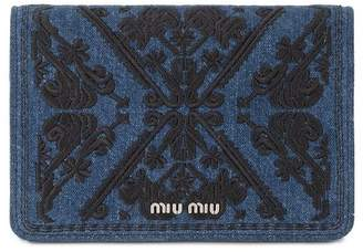 Miu Miu embroidered denim clutch bag