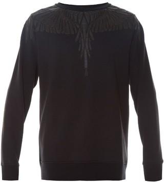 MARCELO BURLON Pando faux-leather appliqué sweatshirt $414 thestylecure.com