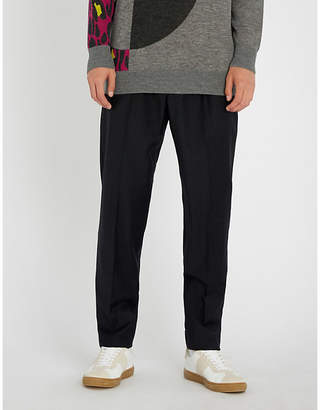 Chalayan Pinstriped tapered woven trousers