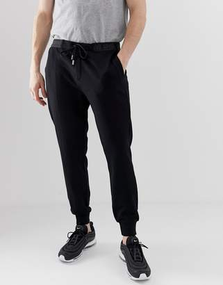 Class Roberto Cavalli skinny joggers in black with logo taping