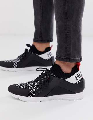 Hybrid multi logo knit trainer in black and white
