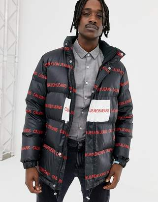 Calvin Klein Jeans puffer jacket with all over logo print black