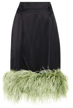 Fur-trimmed satin skirt
