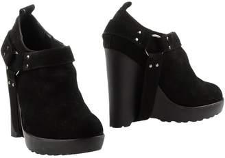 Chloe Sevigny for Opening Ceremony Booties