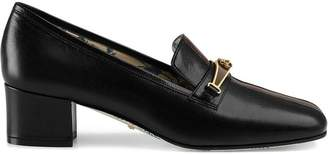Gucci Leather pumps with stripe