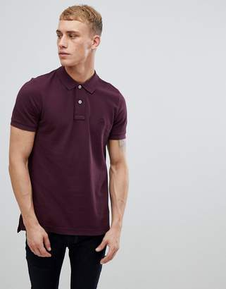 Benetton muscle fit polo shirt in burgundy